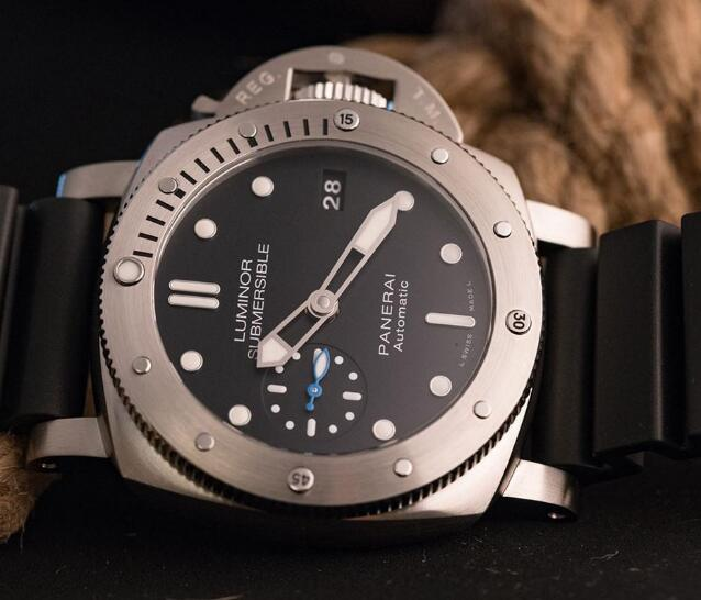 The blue small second hand at 9 o'clock is eye-catching on the black dial.
