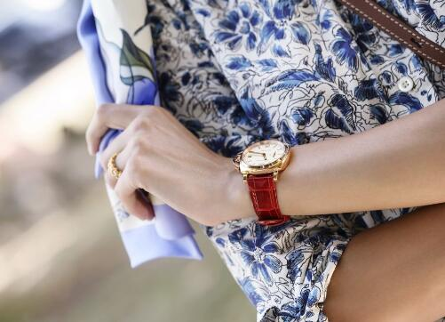 The red leather strap makes the Panerai more charming for women.