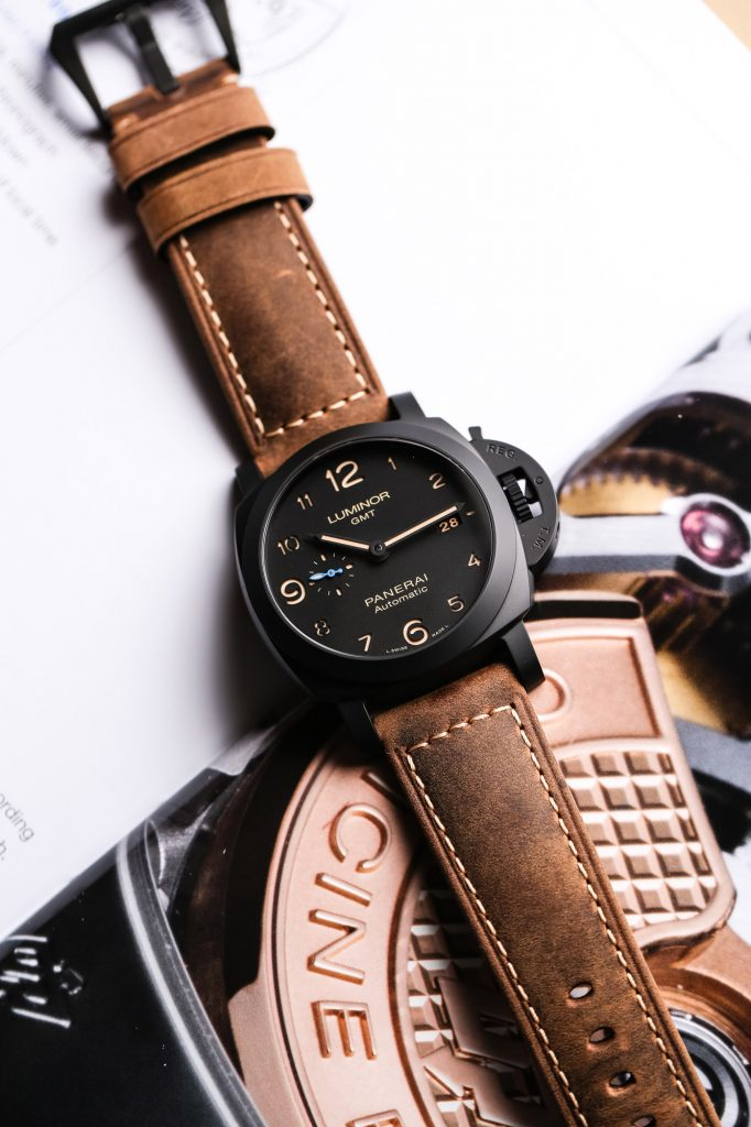 The black dial fake watch has brown strap.